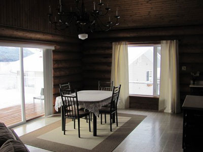 Dining Room in log house at Birch Bay Resort on Francois Lake, BC